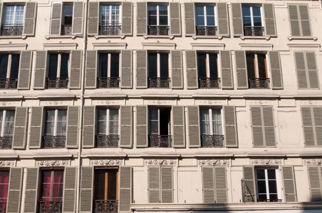Array of window shutters on a Paris street