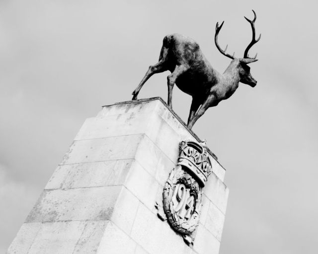 Hertford war memorial, topped by a stag