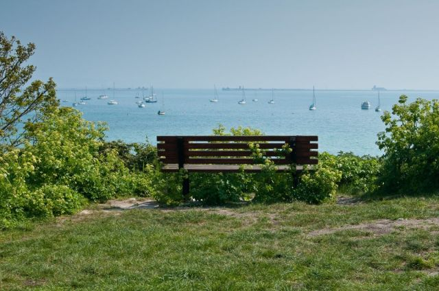 Clifftop bench overlooking a harbour