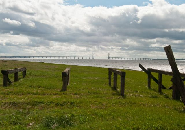 Severn Bridge with decaying wooden jetty in the foreground