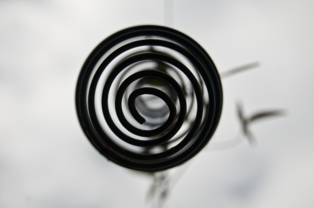 Abstract image - black spiral with background blur