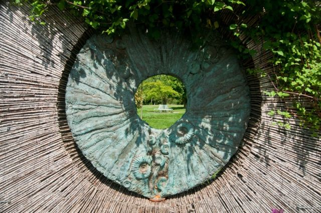 Garden view through gap in sculpture