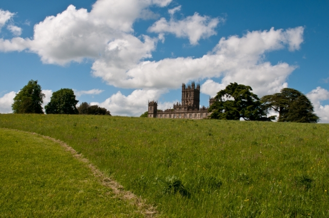 Highclere Castle viewed over a ridge of ground