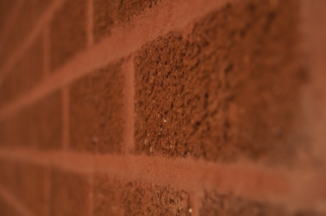 Red brick wall, showing texture of the bricks