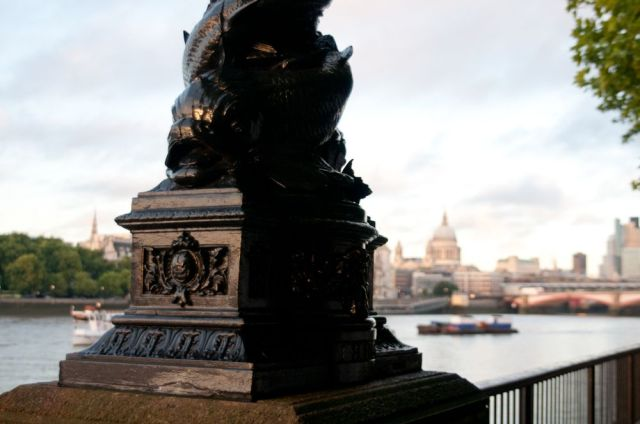 Scultped riverside lamp with view of City of London beyond